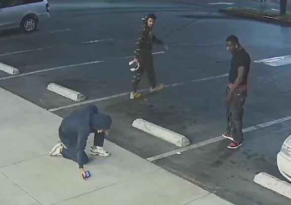 Two robbery suspects walking away from victim